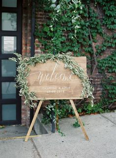a7f0388cc94c Wooden wedding sign with cascading greenery  http   www.stylemepretty.com