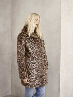 Fluffy: House of Fraser Biba faux fur coat £199 and Mary Portas jeans £55