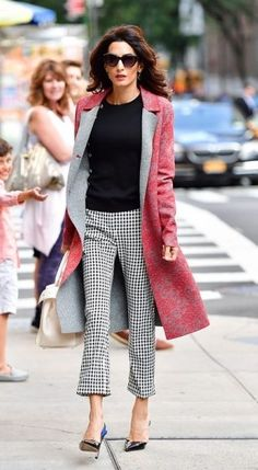 Amal Clooney dominates the streets in a stylish pink coat this spring season.