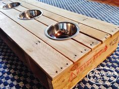 Wooden Recycled Pallet Dog Bowl Table SALVAGEDPALLETS by SalvagedPallets on Etsy https://www.etsy.com/listing/223983388/wooden-recycled-pallet-dog-bowl-table