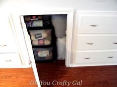 Yarn and fabric storage in attic cubbie around ducts and built in dressers: Oh You Crafty Gal