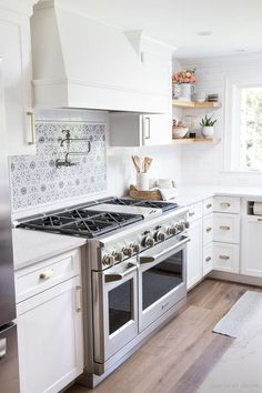 Super gorgeous and functional range with six burners and double ovens. The small oven is perfect for most family meals! #kitchen #kitchens #kitchenrenovation #kitchenreno #kitchenremodel #kitchendesign #kitchenideas #range #appliances #rangehood