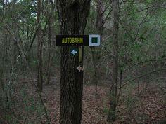 German sign on the trail at Jack Brooks Park.