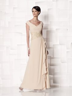 Chiffon mock wrap dress with cap sleeves, tip-of-the-shoulder front and back V-necklines, ruched crisscross bodice accented with asymmetrical hand-beaded lace midriff, side draped skirt with cascading ruffle and sweep train. Sizes: 4 – 20