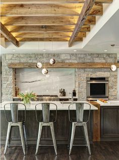 Love the stone and wood beam over the stove, as well as the neutral color scheme.
