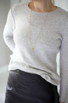 sweater, simple pendant, + black leather skirt