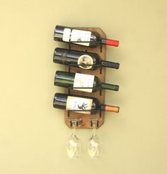 Wall Wine Rack 4 Bottle/ 2 Glass wine rack that complements any bar space or bare wall https://www.etsy.com/listing/277842842/wall-wine-rack-holds-4-bottles-2-glasses?ref=shop_home_active_5