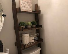This listing is for an over-the-toilet ladder shelf. Its a great space saver. It does ship disassembled so please read the rest of the description. We do have some Dark Walnut stained ladder shelves that ship within 1 business day that you can view here: Small Bathroom Interior, Small Bathroom Sinks, Bathroom Shelves, Bathroom Ideas, Bathroom Organisation, Bathroom Designs, Organization Ideas, Toilet Shelves, Cubby Shelves
