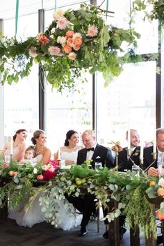 Suspended floral and greenery above head table -  The Wedding Story of Patricia & Duane Gillenwater | WeddingDay Magazine