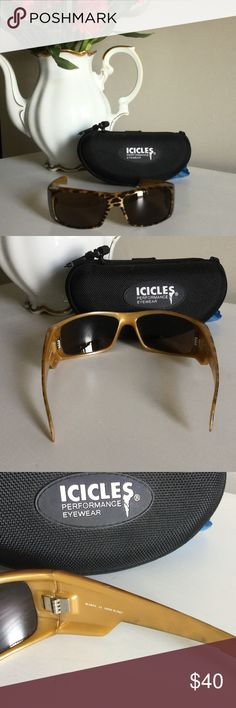 Icicles Sunglasses Leopard print Icicles sunglasses with case.  Farms are durable light weight TR-90 nylon material which helps optimize comfort.  Lenses are made of 2 ml thick poly-carbonate material which meets the ANSI standards for impact resistance and shatterproof protection. Lenses have optimal clarity, 100% protection from harmful UVA, UVB, rays.  Good condition, missing small silver strips on sides. Icicles Accessories Sunglasses