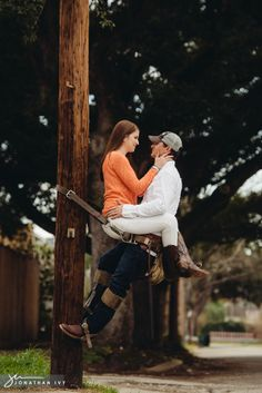 Engagement photos of a lineman and his fiancé on a power pole by @Jonathan Ivy Photography - www.jonathanivyphoto.com