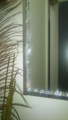 My bathroom mirror makeover...maybe use rhinestones to outline the mirror...MKB