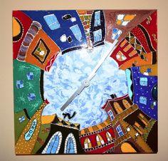 """Nástěnné+hodiny+s+motivem+""""POHÁDKOVÉ+MĚSTO""""+Nástěnné+hodiny+s+motivem+""""POHÁDKOVÉ+MĚSTO""""+Ručně+malované+hodiny,+použitá+barva+na+sklo+značky+Pebeo+Vitrea+160.+Hodiny+lze+omývat.+Rozměry+28x28cm"""