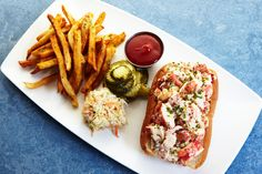 MAINE LOBSTER ROLL French fries, slaw, butter pickles.