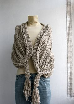 This beautiful Beige Rectangle Knitted shawl is perfect for the changing weather, and will be fun to wear all season long.  This Cable Long Scarf is cozy and stylish. It s very soft and warm.  It is easy to change around for many different looks and styles.  One size fits all  If you are interested in a particular color,let me know.  Perfect for your self or as a gift for that special someone  Item will arrive beautifully packaged.  75% acrylic 25% wool dimensions  for best care:hand wash…