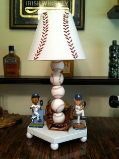 Lamp by Zach and Amy: Baseballs with glove, Dodger bobble heads and woven red leather lamp shade.