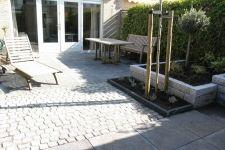 Tuinbestrating: betontegels en granietkeitjes