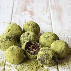 Matcha Date Truffles:  100g walnuts 150g medjool dates 2 tablespoons ground almonds 2 tablespoons cocoa 1½ teaspoons Just Matcha green tea 2 tablespoons honey or maple syrup ½ teaspoon vanilla paste 100g dark chocolate, melted and cooled (at least 70% cocoa solids) 2 tablespoons preserved ginger, diced (optional) 1 teaspoon cocoa powder, for dusting 1 tbsp teaspoon matcha tea, for dusting  LET'S GET COOKING... Line a 22cm x 10cm loaf tin with cling film.  Place the...