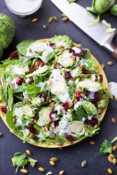 Spinach, Kale, Brussels Sprouts, and Cranberries Superfood Salad with Creamy Poppy-seed Dressing