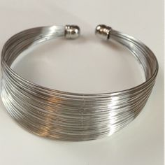 """Wire Cuff Set Silver tone wire cuff bracelet with matching 1""""L silver tone metal fish hook (pierced) earrings. Cuff easy on/off over thumb. Jewelry Bracelets"""