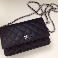 Channel quilted small leather bag