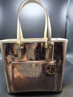 fdf3de1f0f2d Michael Kors Jet Set Signature Metallic Rose Gold Large Snap Pocket MK Tote