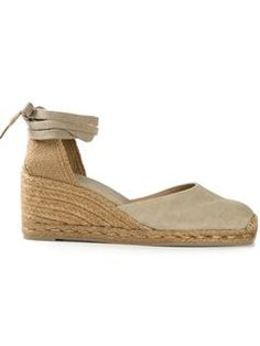 Shop Castañer 'Carina' wedged espadrilles in Spinnaker 101 from the world's best independent boutiques at farfetch.com. Shop 300 boutiques at one address.
