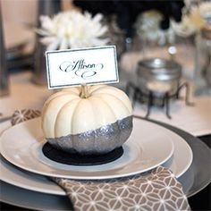 Set your Halloween or Thanksgiving table with glitter-painted pumpkin place cards or menu cards.