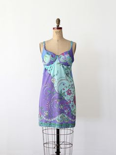 1960s This is a vintage Emilio Pucci for Form Fit Rogers full slip. The silky nylon slip features a fitted bra top with underwire, latch back, and adjustable straps. A swirling floral print colors the