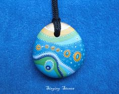 Hand painted stone mandala necklace  This stone was created to bring more balance,harmony and wholeness in your life.  I paint and draw all of