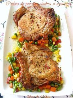 Un cotlet de porc este o minune in sine, dar daca il asezonam cu o crenguta de cimbru, cativa usturoi si putin ghimbir taiat in felioare subtiri, totul la cuptor sa se caramelizeze si spre s… Pork Recipes, Cooking Recipes, Healthy Recipes, Baking Classes, Good Food, Yummy Food, Romanian Food, Spinach Stuffed Chicken, Food To Make