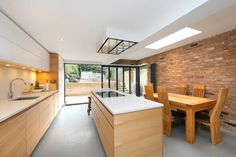 ​kitchen extension dulwich with flat roof and open brickwork (De nuspace)