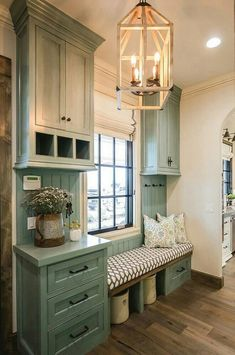 Cabinets need to be a sage or avocado green but I love the floral arrangement in the watering can