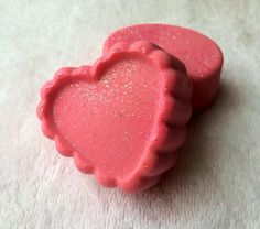 Handmade Sugar Scrub Soap. Black Cherry fragrance. Made with my hand made soap, Salt, organic coconut oil, olive oil, palm oil, shea butter, avocado oil, Beeswax, color (mineral mica powder & glycerin) and topped with cosmetic glitter. Each soap weighs about 3.5 oz.   I have a heart shaped soap...