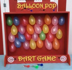 A game of balloon shoot is always a blast! Hang a bunch of colorful balloons in this stand and leave some darts out for your guests to have a go at seeing who can pop the most balloons! The prize goes to whoever pops the most! See more party ideas and share yours at CatchMyParty.com Carnival Party Foods, Diy Carnival Games, Carnival Birthday Parties, Carnival Themes, Birthday Games, Birthday Party Themes, School Carnival Games, 2nd Birthday, Lego Party Games