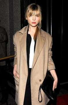 Clemence Posey: Love the camel coat, black suit, black clutch and white blouse.