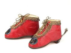 Child's shoes in red leather with a kid and silk lining and gold thread edging and laces embroidered with the Royal personal crest of King Frederick William II of Prussia, 1750-1755, Germany. The shoes are fitted with period silver-leaf spurs. The provenance is impeccable as they are part of a Property of items formerly in the possession of Queen Charlotte, wife of George III, given to her daughter Princess Sophia, then upon her death to a Lady in waiting.