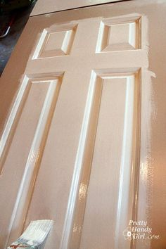 How to paint doors like a pro. I used a small foam roller and angled paint brush! They look great. Worst part is just waiting between coats and to flip it over!