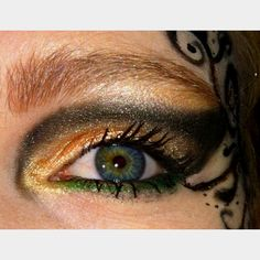 My gothic fairy makeup. Gold and black cut crease with green underneath.