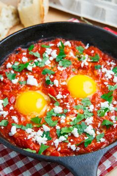 Shakshuka - eggs poached in a tomato and pepper sauce -  top with parsley and crumbled feta - approx 5 carbs per serving