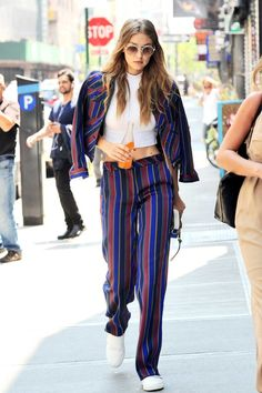 A bright striped trouser is perfect for the office during summer. Pair it with white sneakers like Gigi Hadid when you're off the clock for a cool-girl take on polished workwear.