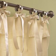 Napkin rings and ribbons for hanging curtains/shower rod... love!