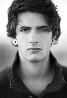 cute piercings... Let's just forget about the attractive guy and focus on his piercings.... :P