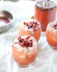 Cranberry Cider Punch: This Christmas cocktail combines two staple flavors with spiced syrup for a winter warm refreshment. Find more easy, festive and party ready Christmas cocktail and big batch punch recipes and ideas that are filled with champagne, vodka, bourbon, rum, gin and more here.