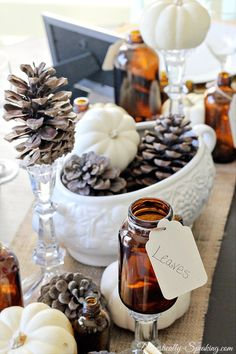 How to Create a Fall Vignette-put pinecones and pumpkins on thrifted crystal candleholders