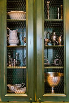i might be switching the glass in the doors of my china hutch for chicken wire