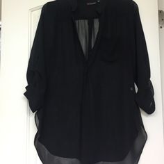 Sheer long black top Very sheer long slight high/low , one front pocket and sleeves roll up to 3/4 sleeve and button, wore once , doesn't fit unfortunately or I would keep Ultra flirt Tops Blouses