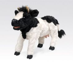 Use puppet to discuss cow facts: they have hoofs, some have horns, udders for milk, etc.