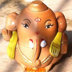 As the name suggests, this very adorable, all round and healthy ganesha is hand made on a small potters wheel with very refined clay.