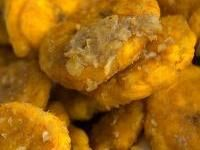 Tostones, twice-fried green plantains, are a favorite snack and side dish in Puerto Rico, Cuba and the Dominican Republic. Haitians call them bananes pesées, or banan peze. They are also eaten in Central America and throughout South America. In Ecuador, Peru and Venezuela they are known as patacones.